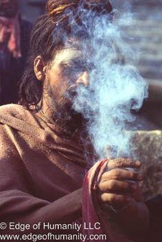 Sadhu smoking a chillum pipe outside of the Pashupatinath Temple, Nepal