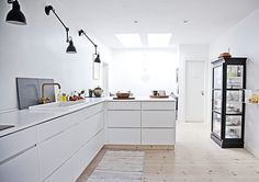 Kitchens without upper cabinets seem open and i like the look. Upper cabinets are not always so practical and are hard to reach and clutter up a room. Great look.