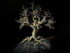 a little decorative tree made of wire and beads