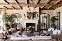 outdoor sunrooms | Green and blue pop against a grey stone floor in this outside ...