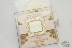 A beautiful blush, acrylic quince invite with a touch of lace.