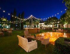 outdoor wedding lounge + cafe lights + dance floor