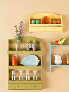 Show-Off Spice Racks ~ Thrift store finds given fresh coat of paint, grouped together as curio shelving.