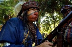Paul Morrison-Swamp Owl-of Leesburg, gets ready to take on the US  Army during a re-enactment of the second Seminole War