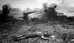 A dead Japanese soldier and wrecked tank, Type 97 Chi Ha. Saipan 1944.