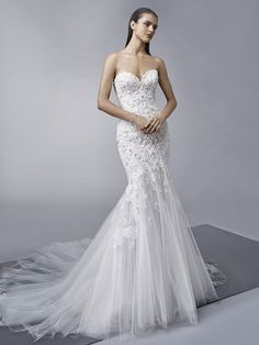 Mila: Classic romance is embodied in this full-length mermaid gown with a strapless sweetheart neckline bodice adorned with intricate lace embellishments sprinkling down to the ethereal, breezy tulle skirt. Finished with an invisible back zipper closure.