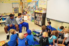 Seth Curry and Tyler Thornton read to students at Triangle Day School in Durham.