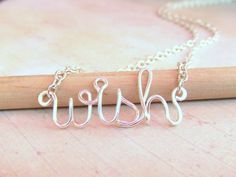 Wish Necklace Silver Word Necklace Up to 8 Letters Word Necklace Word Jewelry Teen Jewelry Wire Wrapped Jewelry Gifts Under 20. $16.95, via Etsy.