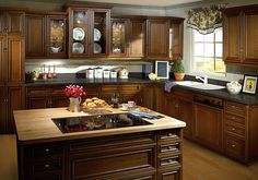 Whether for a kitchen or bathroom remodel, browse DeWils selection of custom cabinets and find the style, color, and cut that you're looking for. Interior Wall Colors, Stone Tile Flooring, White Mosaic Tiles, Craftsman Home Interiors, White Countertops, Dark Counters, Dark Kitchen Cabinets, Luxury Kitchens, Dream Kitchens