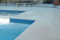 Ivory Sandstone Pool. Classic off white pool tile supplied by Gaia Stone. For more information go to www.gaiastone.com.au