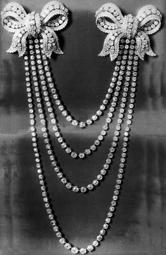 Empress Eugénie of the French's pair of shoulder knot brooches and the 'Collier aux Quatre Rivières' (Bapst, 1863).