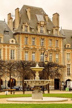 Place des Vosges , Paris - in the 2nd arr. in Paris. The world's first purposely designed urban square.