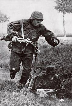 Wiking Division machine gunner dashes forward...