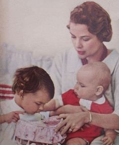Grace and her children, Caroline and Albert, celebrating Christmas 1958. Picture by Howell Conant.