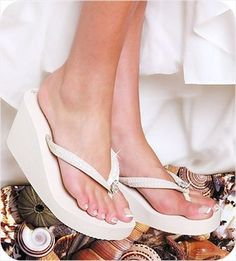 Bling bling platform flip flops that come in white, ivory, black or brown. Definitely not a good idea for a winter wedding, but cute idea for all those flip flop fans out there like me.