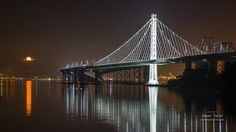 ~~~~ MEMORIAL DAY SALE now thru 5/31! 15% off all framed and unframed prints, metal prints and canvas gallery wraps. No coupon code necessary, prices already reduced ~~~~     This large fine art San Francisco panorama print of the Full Moon rising over the San Francisco–Oakland Bay Bridge was photographed after a series of winter rain storms were clearing. Title: Full Moon and New Bay Bridge, San Francisco  We offer museum grade limited edition prints and canvas gallery wraps photographe...