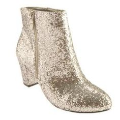 @Overstock.com - Womens BCBGeneration Charm Silver Glitter - This glittered, zippered ankle boot offers a fashionable shoe for special occasions.  http://www.overstock.com/Clothing-Shoes/Womens-BCBGeneration-Charm-Silver-Glitter/7828457/product.html?CID=214117 $93.95