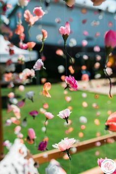 DIY hanging flower garlands as the main decor for a flower themed birthday party. In a Field of Roses, She is a Wildflower: A Flower Themed Birthday Party by Allison Carter Celebrates decor diy party Boho Flower Birthday Party Plan First Birthday Parties, Girl Birthday, Spring Birthday Party Ideas, 18th Birthday Party Ideas For Girls, Cute Birthday Ideas, Birthday Month, Bohemian Birthday Party, Boho Themed Party, Tinkerbell Party Theme