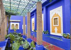 The lush gardens of Marrakech!!! Bebe'!!! Love this blue walled open courtyard!!!