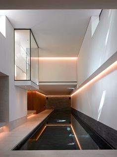 Theis + Khan updates Notting Hill Gate house with basement pool and cinema Indoor Swimming Pools, Swimming Pool Designs, Cinema Architecture, Underground Pool, Basement Pool, Basement Ideas, Basement Plans, Playroom Ideas, Luxury Cabin