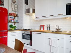 much like our London home, smeg and all. our cupboards and tiles could do with some updating though. this looks achievable :) Red Kitchen Decor, Kitchen Interior, Kitchen Design, Open Plan Kitchen, New Kitchen, Kitchen Wood, Kitchen Cupboards, Red And White Kitchen, Cuisines Design