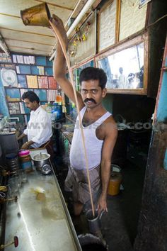 Indian Man Making Chai Tea With A Long Pour In Trichy, South India:  Not something i'd attempt - my chai would be on the floor! :-)
