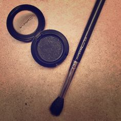 MAC Black Tied [Velvet] Eye Shadow MAC Black Tied eyeshadow. Has a velvety finish with a subtle silver glitter to it. Was only used a few times. Excellent condition. Please note: does not have original box and brush not included. MAC Cosmetics Makeup Eyeshadow