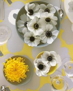 A simple way to freshen up reception tables? Float your flowers: