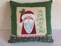 A personal favorite from my Etsy shop https://www.etsy.com/listing/255524119/santa-pillow-christmas-cross-stitch