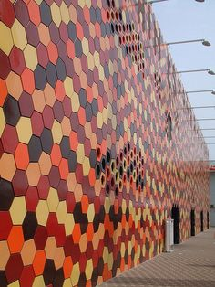 Pretty busy pattern but like the different shades of the cafes colours. Orange, Tan, Rust, and Black (Foreign Office Architects' Spanish Pavilion for Expo Orange Architecture, Wood Architecture, Architecture Details, Aichi, Facade Design, Design City, Arch Building, Landscape Walls, World's Fair