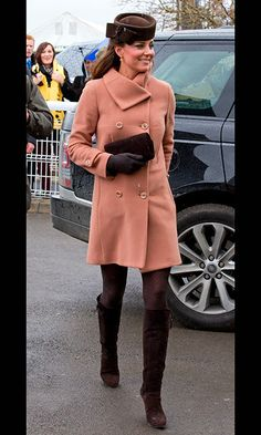 At the Cheltenham Festival, Kate paired her pink Joseph coat with brown patterned tights and brown boots to the knee.