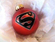 """""""Superman"""" Ornament - could make something like this for """"green lantern"""", """"captain america"""" and """"Iron man"""" using sharpie paint pens!"""