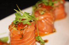 Love Roll: salmon sashimi, wrapped around tuna tartar, avocado and crab. It was topped with a spicy lime ponzu sauce, salmon roe, shallots and cilantro