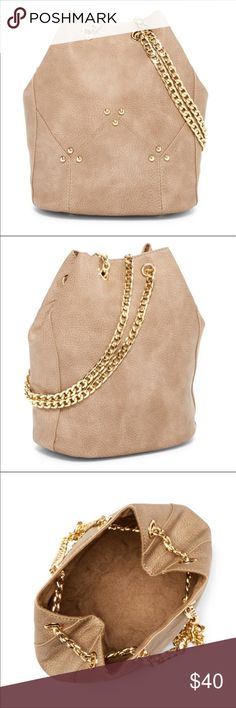 Taupe/beige/grey bucket bag This bucket bag is all you need for a bit of a statement and functionality. This good looking bag is adorned with gold accents and shoulder chain to really make things pop. Add a little spice to your outfit. The color name is grey and on my computer the photos look beige. I would say taupe is pretty accurate. But every computer is different. Classic styling beautiful twist. Pink Haley Bags Hobos