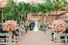 Coral wedding ceremony colors: http://www.stylemepretty.com/little-black-book-blog/2014/10/10/boca-raton-resort-wedding-full-of-tropical-elegance/ | Photography: Justin DeMutiis - http://justindemutiisphotography.com/
