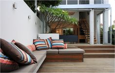 A wonderful modern patio by Secret Gardens of Sydney. Love all the comfy seating.