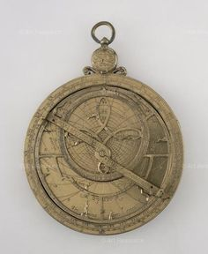 Astrolabe, 1574. The mater bears the markings for a Quadratum Nauticum ('nautical square'), used by mariners for navigational calculations, and the back shows the universal projection as described by Gemma Frisius in his treatise on the 'Catholic Astrolabe' in the mid-sixteenth century. Made by Humphrey Cole
