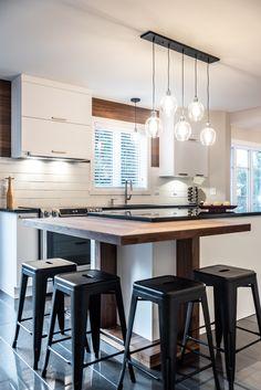 This kitchen features stained cherry and melamine, which imitates … - Modern Kitchen Benchtops, Kitchen Flooring, Kitchen Dining, Kitchen Decor, Kitchen Mat, Küchen Design, House Design, House Made, Kitchen Interior
