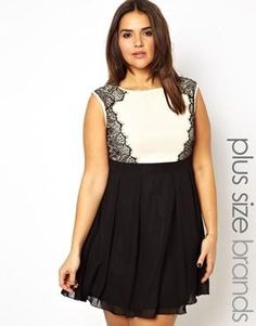 I want this dress even if it looks like something a waiter would wear!!!