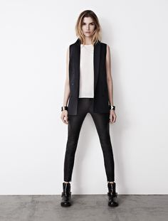 black sleeveless blazer with leather pants