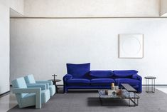 The Maralunga Sofa designed by Vico Magistretti features a lounge chair, ottoman, and sofas avail­able in both two-seat and three-seat sizes. Sofa Design, Furniture Design, Interior Design, Seat Available, Office Sofa, Seat Cushions, Ottoman, Lounge, Living Room