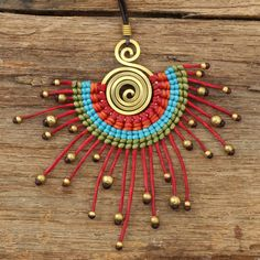 Tribal designs necklace in red orange and blue by cafeandshiraz, $32.00