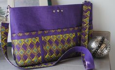 Purple Paradise was a custom order.  Rich purple linen like fabric accented with bright green multi colored cotton made this one a bold statement!  This bag is a messenger style with adjustable handles!  Check out Bobbin My Thread on Facebook for more styles from Nena!