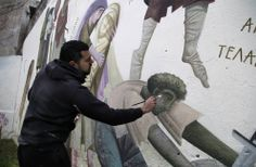 In this photo taken on Friday Feb. Greek street artist Fikos paints a wall in the Kolonos area of Athens. The painter studied Byzantine. Athens Greece, Street Artists, Art Forms, Graffiti, Tourism, Greek, Pictures, Painting, Byzantine