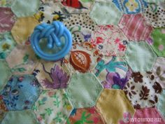 vintage button on mini hand pieced and hand quilted hexie