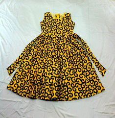 A beautiful little African Ankara dress for toddlers and kids. Available in 5 color options. Features * cotton * Back zipper * Comes with a head band Sizes Chart SIZE LENGTH CHEST WAIST HEIGHT (Shoulder to hem) 15 18 17 19 19 18 20 19 Baby African Clothes, African Dresses For Kids, African Wear Dresses, African Girl, Latest African Fashion Dresses, Dresses Kids Girl, African Shop, African Style, Dress Girl