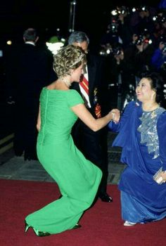 Great picture! Diana bowing to royalty and, in turn, Royalty bowing to Diana.