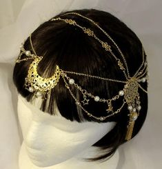 Made to order: Milky Way Head-chain Sparkling with glamour this elegant head chain is sure to dazzle. Featuring a filigree crescent moon and many star charms it is inspired by our very Wedding Jewelry And Accessories, Hair Accessories, Chain Headband, Chain Headpiece, Headdress, Head Chain Jewelry, Filigree Jewelry, Charm Jewelry, Diy Jewelry