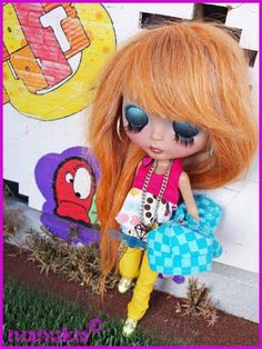 Blythe doll....  The personaliy they give these dolls with the looks is awesome, I WANTEM ALL lol