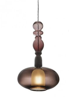 [Hand Blown Glass Lights by Curiousa & Curiousa] I can see this working beautifully in a global decor, especially one that has a Moroccan theme. This looks like an ancient amphora shape, or a perfume bottle.